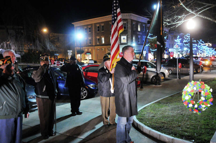 Christopher Hughes, Commander of the Greenwich Legion Post 29, leads the ceremony recognizing the anniversary of the attack on Pearl Harbor at the war memorial on Greenwich Avenue in Greenwich, Conn., Dec. 7, 2013. Photo: Keelin Daly / Stamford Advocate Freelance