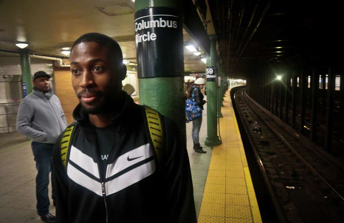 Dennis Codrington, who rescued a man after he onto the subway tracks, stands near the site of the incident on the Columbus Circle subway platform on Thursday, Dec. 5, 2013 in New York. Codrington doesn?'t know what happened to the man he saved, but he hopes he survived and is healthy. (AP Photo/Bebeto Matthews) ORG XMIT: NYBM301