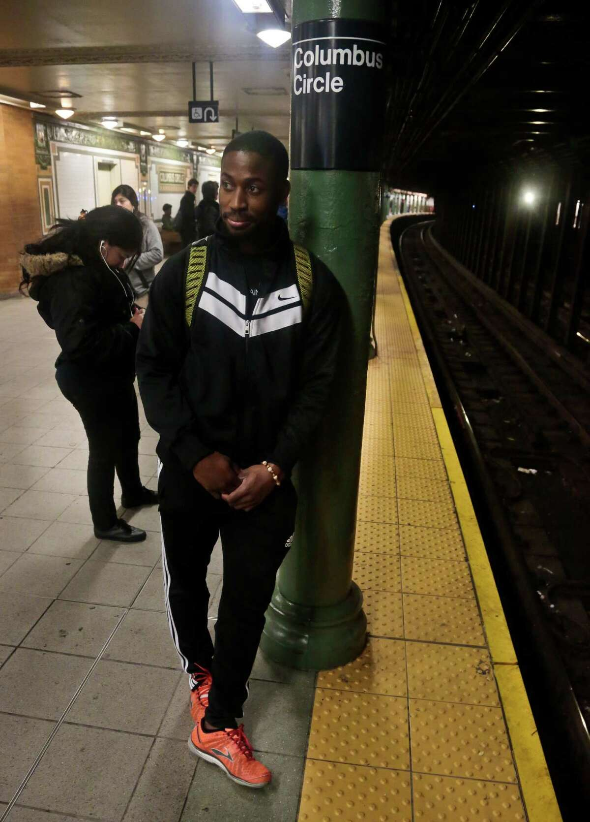 Dennis Codrington, who rescued a man after he onto the subway tracks, stands near the site of the incident on the Columbus Circle subway platform on Thursday, Dec. 5, 2013 in New York. Codrington doesn?'t know what happened to the man he saved, but he hopes he survived and is healthy. (AP Photo/Bebeto Matthews) ORG XMIT: NYBM302