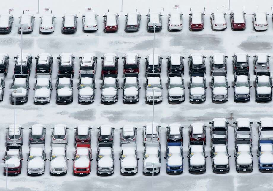 Ice covered vehicles sit in a automotive dealer lot Saturday, Dec. 7, 2013, in Lewisville, Texas. Photo: Tony Gutierrez, Associated Press / AP