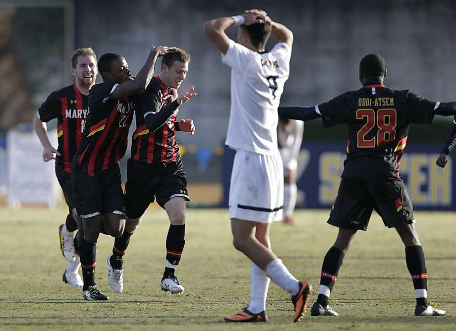 Maryland's Michael Sauers (third frrom left) is congratulated by teammates after scoring the go-ahead goal late in the second half which beat the Cal Bears 2-1 in an NCAA quarterfinals soccer match in Berkeley, Calif. on Saturday, Dec. 7, 2013. Photo: Paul Chinn, The Chronicle