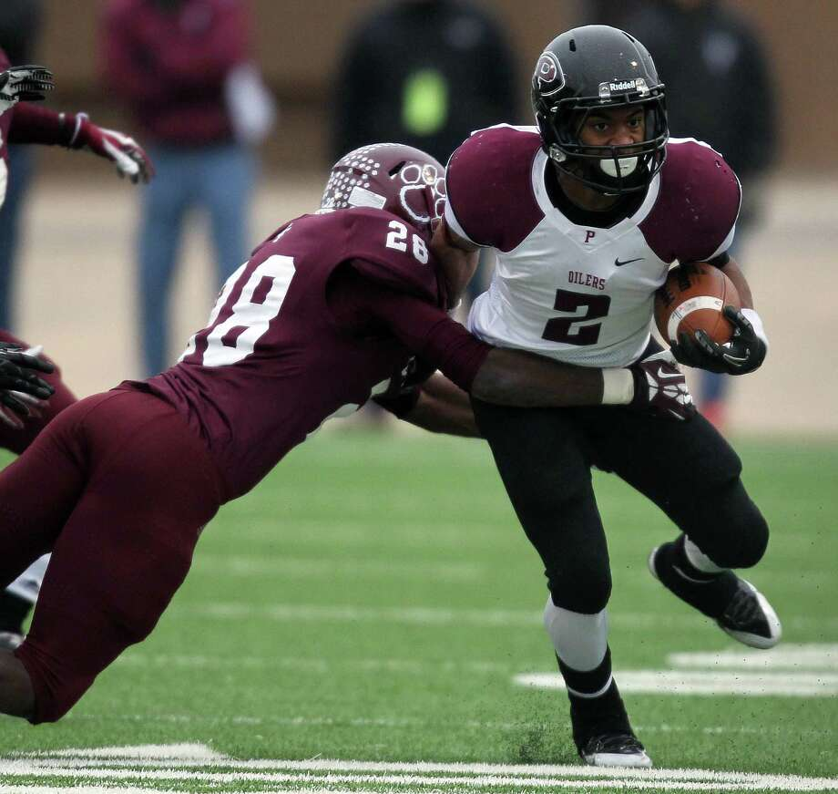 Pearland's JaColbie Butler (2) is tackled by Cy-Fair's David Nelson during the second half of a high school football playoff game, Saturday, December 7, 2013, at Mercer Stadium in Sugar Land. Photo: Eric Christian Smith, For The Chronicle