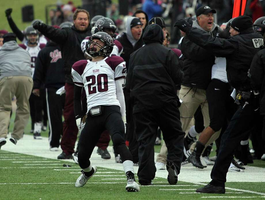 Pearland's Conner Chidester (20) celebrates the Oiler's defensive stop late in the fourth quarter, sealing the Oilers' 10-3 victory over Cy-Fair in a high school football playoff game, Saturday, December 7, 2013, at Mercer Stadium in Sugar Land. Photo: Eric Christian Smith, For The Chronicle