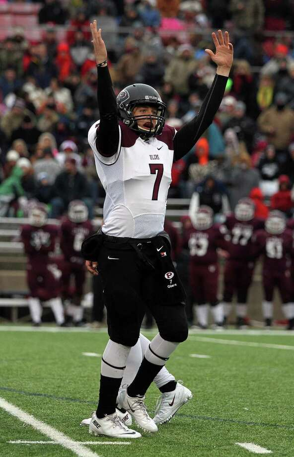 Pearland quarterback Connor Heath celebrates the Oiler's 10-3 victory over Cy-Fair in a high school football playoff game, Saturday, December 7, 2013, at Mercer Stadium in Sugar Land. Photo: Eric Christian Smith, For The Chronicle