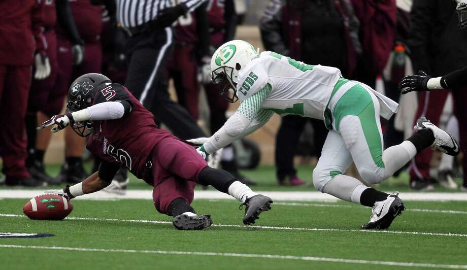 Brenham 35, George Ranch 6George Ranch's Xavian Marks (5) recovers his fumble past Brenham's Ja'Michael Adams during the first half of a high school football playoff game, Saturday, December 7, 2013, at Tully Stadium in Houston. Photo: Eric Christian Smith, For The Chronicle