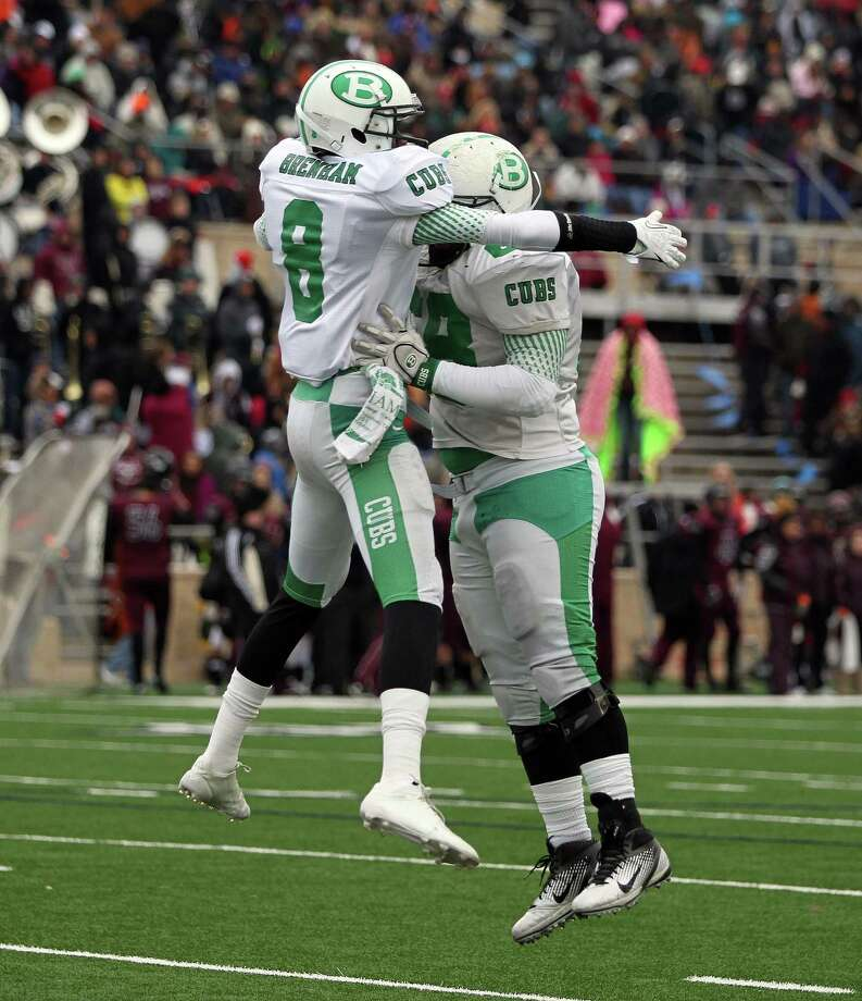 Brenham's Tre'Vonte Johnson, left, celebrates his 49-yard touchdown reception with teammate Neal Mathis during the first half of a high school football playoff game against George Ranch, Saturday, December 7, 2013, at Tully Stadium in Houston. Photo: Eric Christian Smith, For The Chronicle