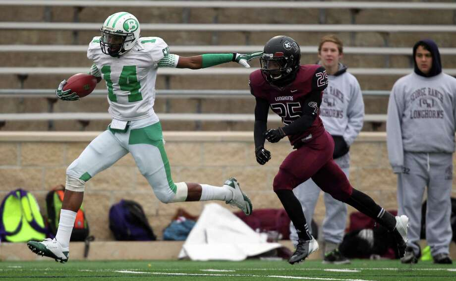 Brenham's Courtland Sutton, left, pushes away from George Ranch's Melton Finley for a 61-yard touchdown reception during the first half of a high school football playoff game, Saturday, December 7, 2013, at Tully Stadium in Houston. Photo: Eric Christian Smith, For The Chronicle