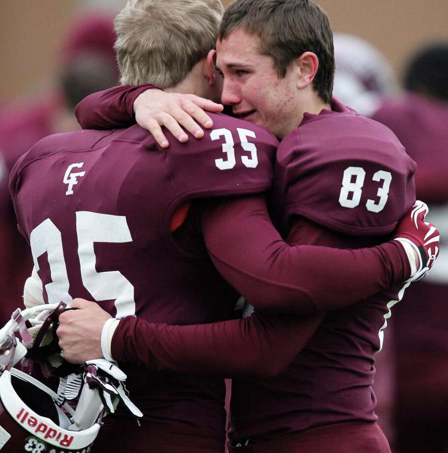 Cy-Fair's Reid Kelly (83) hugs teammate Austin Scheaffer after the Bobcats' 10-3 loss to Pearland in a high school football playoff game, Saturday, December 7, 2013, at Mercer Stadium in Sugar Land. Photo: Eric Christian Smith, For The Chronicle