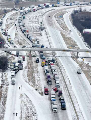 Drivers stuck on icy I-35 as cold blast hits Texas