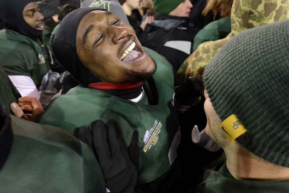 Baylor cornerback Demetri Goodson celebrates after defeating Texas 30-10 for the Big 12 title in Waco on Dec. 7, 2013. Goodson had a reason to celebrate again Saturday when he was picked in the sixth round of the 2014 draft by the Green Bay Packers. (AP Photo/The Daily Texan, Charlie Pearce) Photo: Charlie Pearce, Associated Press / The Daily Texan