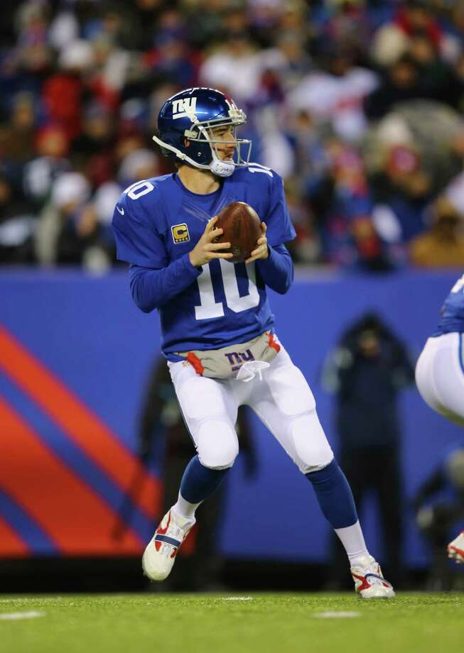 EAST RUTHERFORD, NJ - NOVEMBER 24:   Eli Manning #10 of the New York Giants drops back to pass against the Dallas Cowboys during their game at MetLife Stadium on November 24, 2013 in East Rutherford, New Jersey.  (Photo by Al Bello/Getty Images) ORG XMIT: 184893262 Photo: Al Bello / 2013 Getty Images
