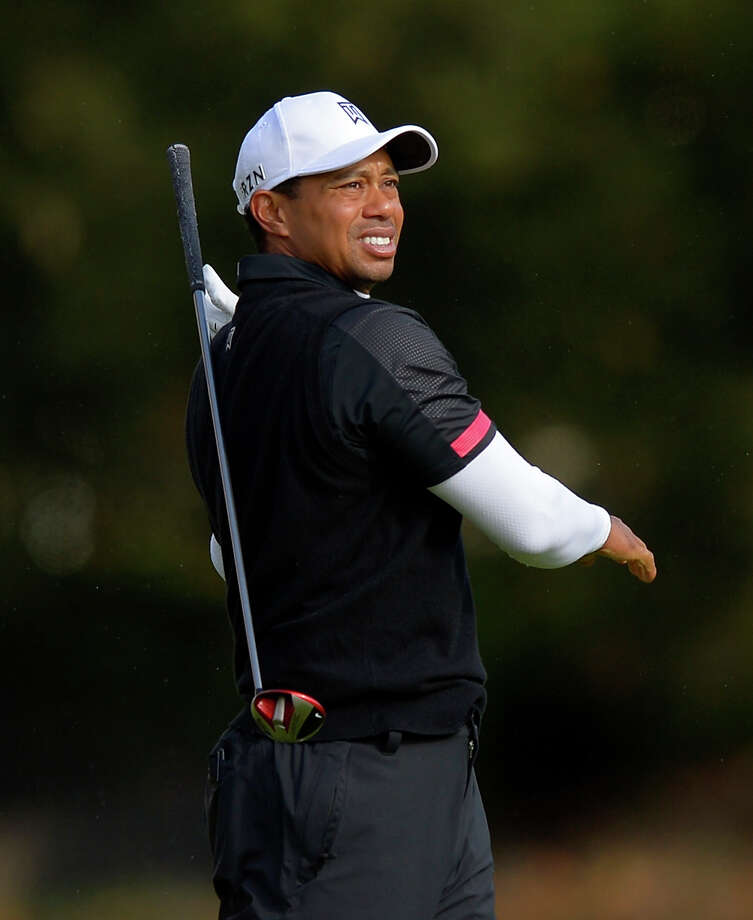 Tiger Woods drops his club as he makes his approach shot on the fifth hole during the third round of the Northwestern Mutual World Challenge golf tournament at Sherwood Country Club, Saturday, Dec. 7, 2013, in Thousand Oaks, Calif. (AP Photo/Mark J. Terrill)  ORG XMIT: CAMT102 Photo: Mark J. Terrill / AP