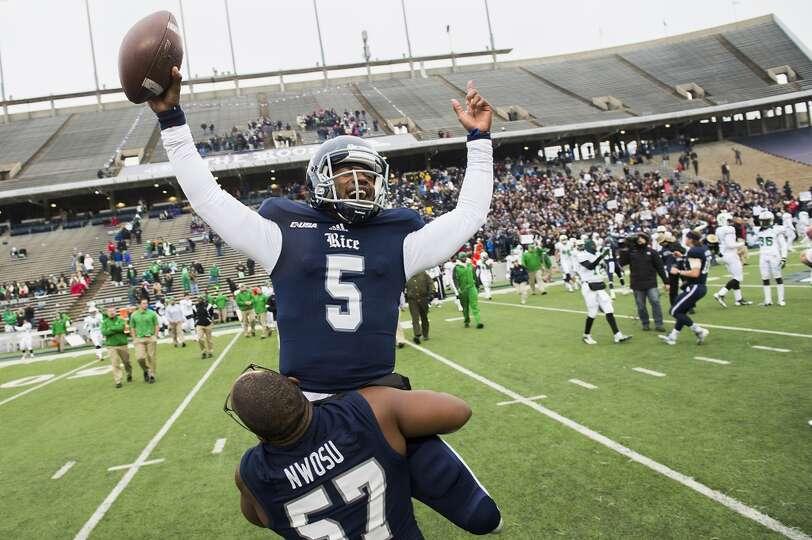 Rice quarterback Driphus Jackson (5) celebrates with linebacker Cameron Nwosu (57) after the Owls de