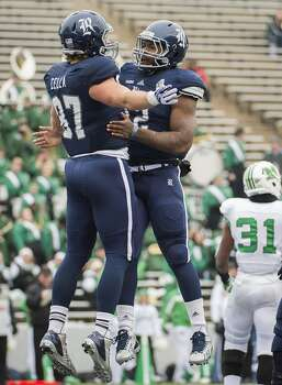 Rice tight end Connor Cella (87) celebrates with running back Charles Ross (12) after scoring on a 8-yard touchdown pass during the second half. Photo: Smiley N. Pool, Houston Chronicle