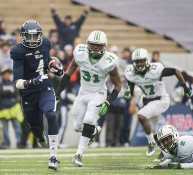 Rice wide receiver Dennis Parks (4) races for a first down past Marshall linebacker Evan McKelvey (31), safety Taj Letman (17) and defensive back Derrick Thomas (2). Photo: Smiley N. Pool, Houston Chronicle