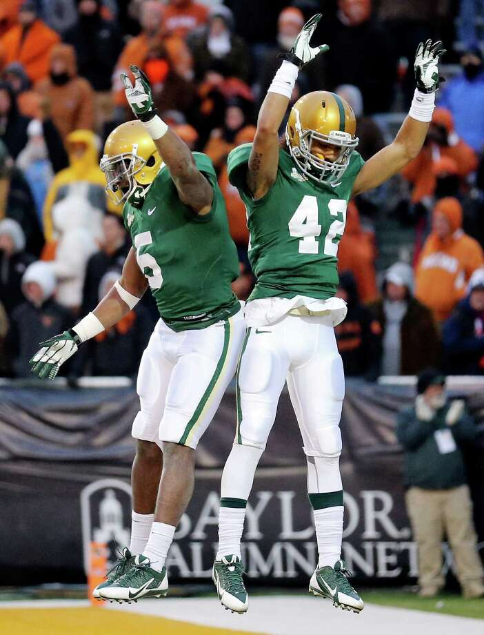 Baylor Bears wide receiver Antwan Goodley (left) celebrates with teammate Baylor Bears wide receiver Levi Norwood after Norwood scored a touchdown during second half action against the Texas Longhorns Saturday Dec. 7, 2013 at Floyd Casey Stadium in Waco, Tx. Baylor won 30-10. Photo: Edward A. Ornelas, San Antonio Express-News / © 2013 San Antonio Express-News