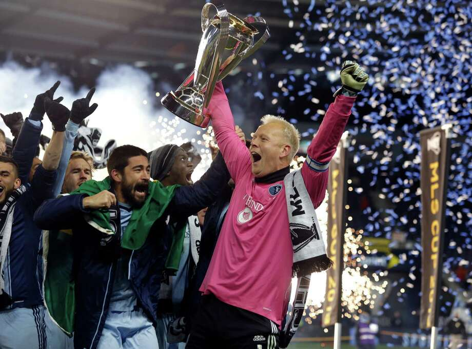 Paulo Nagamura , left, and Jimmy Nielsen of Sporting Kansas City celebrate the team's hard-earned victory in a lengthy penalty kick shootout. Photo: Ed Zurga, Stringer / 2013 Getty Images