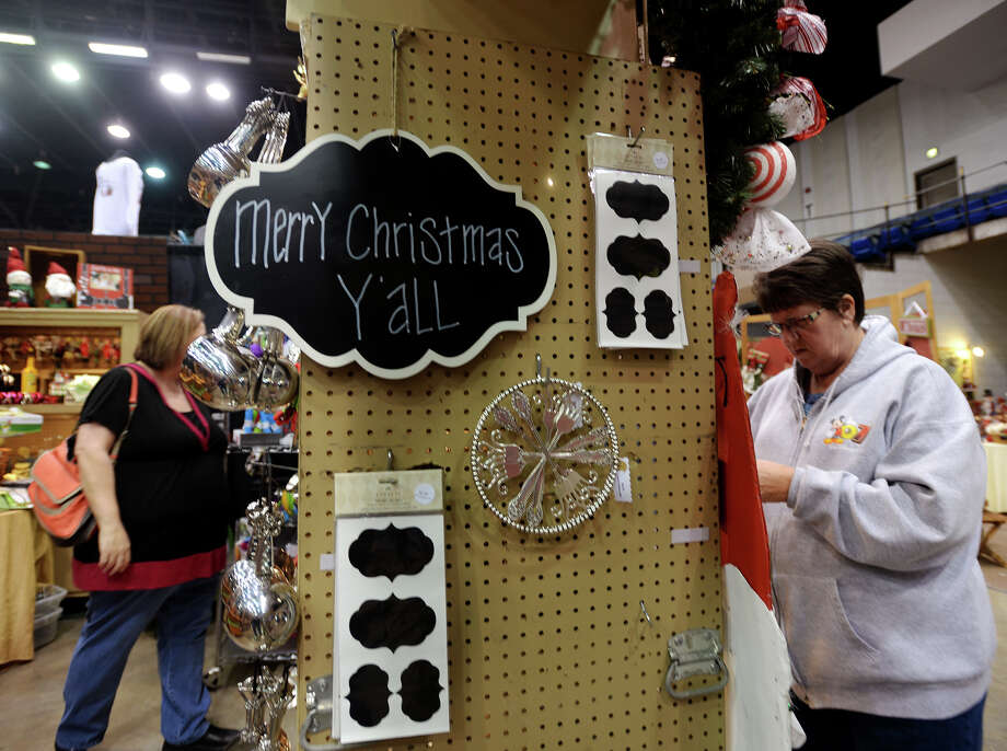 Chery Leemhuis, left, and Diana Seamon, right, browse through the wares of Kelea's on Saturday afternoon. The Main Street Market, an annual fundraiser for the Junior League of Beaumont, went on at the Civic Center from Thursday to Saturday. Proceeds of the market gathered by the League will go to its local community projects, said Cindy Partin, president of the local chapter. This year, the Market's ninth, saw an attendance of at least 5600, according to Market co-chair Lauren Martin. Photo taken Jake Daniels/@JakeD_in_SETX Photo: Jake Daniels / ©2013 The Beaumont Enterprise/Jake Daniels