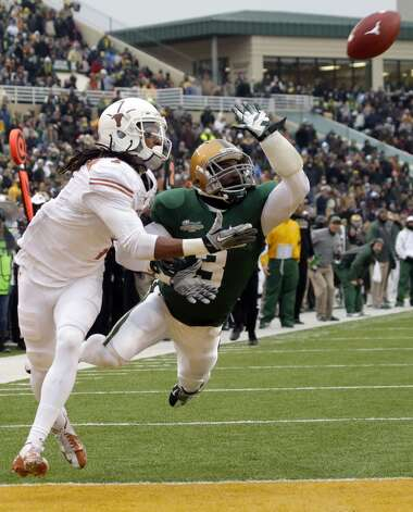 Baylor cornerback Demetri Goodson (3) breaks up a pass in the end zone against Texas wide receiver Marcus Johnson (7). Photo: LM Otero, Associated Press