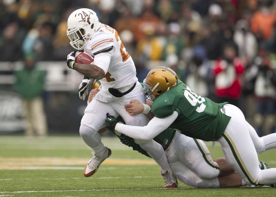 Texas running back Joe Bergeron is tackled by Baylor defenders Trevor Clemmons-Valdez and Byron Bonds. Photo: Jay Janner, McClatchy-Tribune News Service