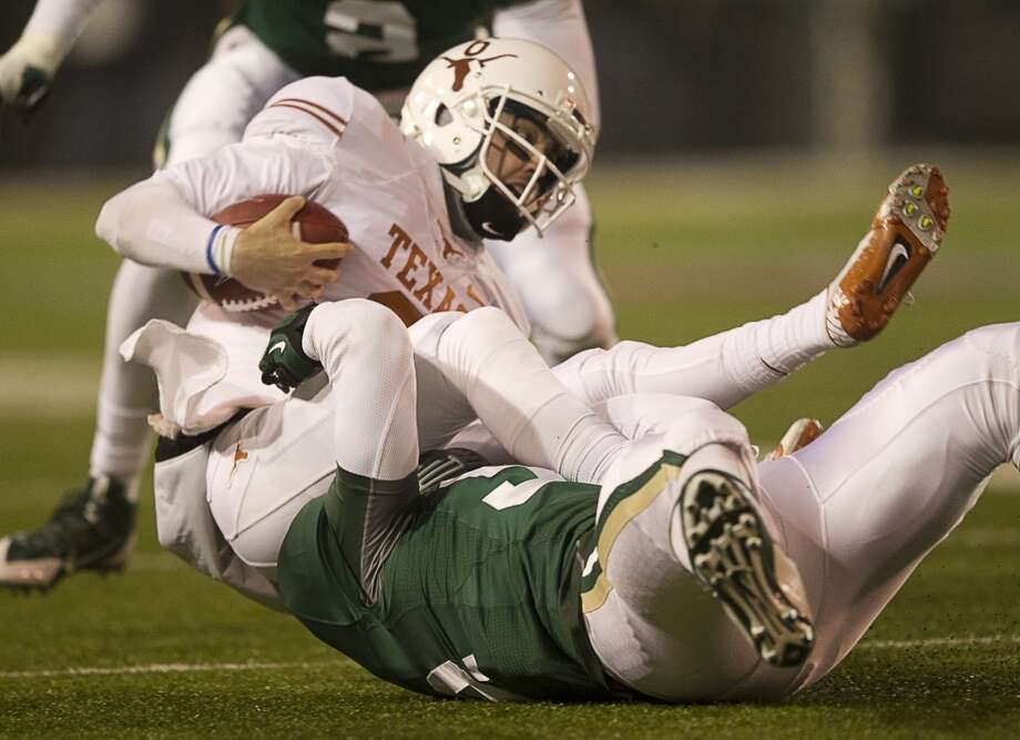 Texas quarterback Case McCoy is sacked by Baylor's Jamal Palmer. Photo: Jay Janner, McClatchy-Tribune News Service