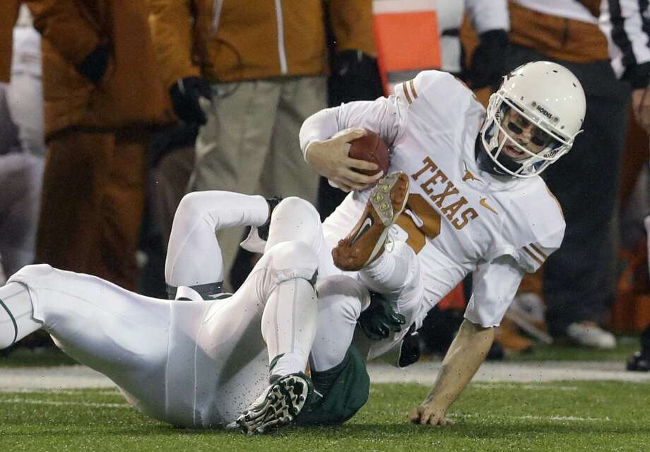 Texas quarterback Case McCoy (6) is sacked by Baylor defensive end Jamal Palmer. Photo: LM Otero, Associated Press