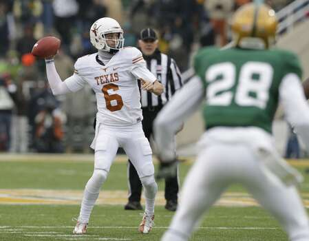 Texas quarterback Case McCoy (6) passes as Baylor safety Orion Stewart (28) looks on. Photo: LM Otero, Associated Press