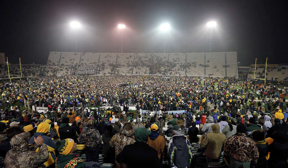 Baylor Bears football fans fill the field at Floyd Casey Stadium after the game with the Texas Longhorns Saturday Dec. 7, 2013 in Waco, Tx. Baylor won 30-10. Photo: Edward A. Ornelas, San Antonio Express-News / © 2013 San Antonio Express-News