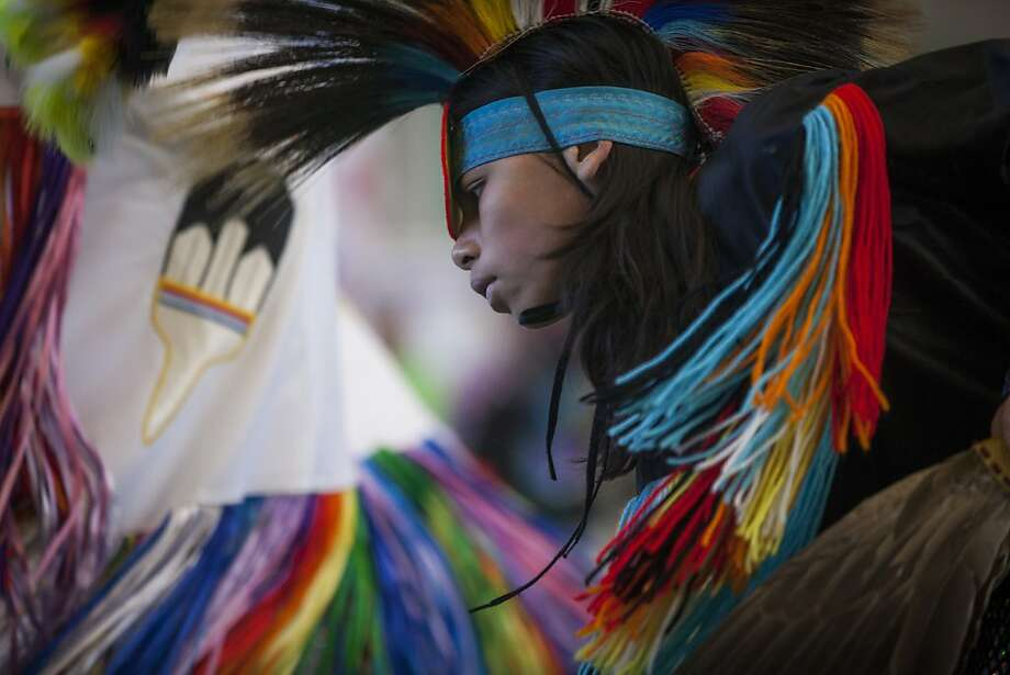 Angel Garcia dances during the fifth annual powwow sponsored by the American Indian Child Resource Center and held at Laney College in Oakland. Photo: Sam Wolson, Special To The Chronicle