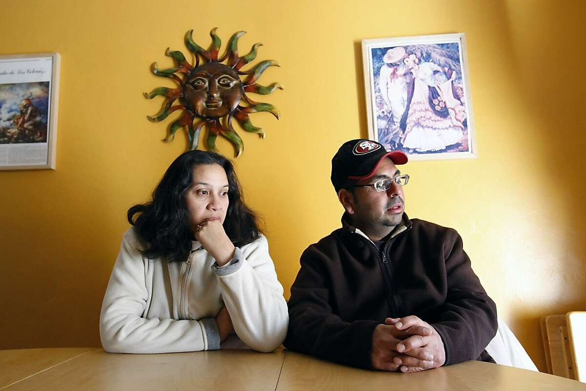 Robert and Patti Castillo sit at the dinning room table while talking about their home which they bought for $420,000 in 2005 and is now worth about $125,000, in Richmond, CA, Saturday, December 7, 2013. The city of Richmond is pushing a new and somewhat controversial plan to use eminent domain to seize homes that have underwater mortgages.