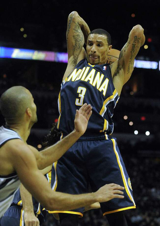 George Hill, guard with Pacers, averaging 11.1 points, 3.8 rebounds, 3.6 assists in 2014. Photo: Billy Calzada, San Antonio Express-News / San Antonio Express-News