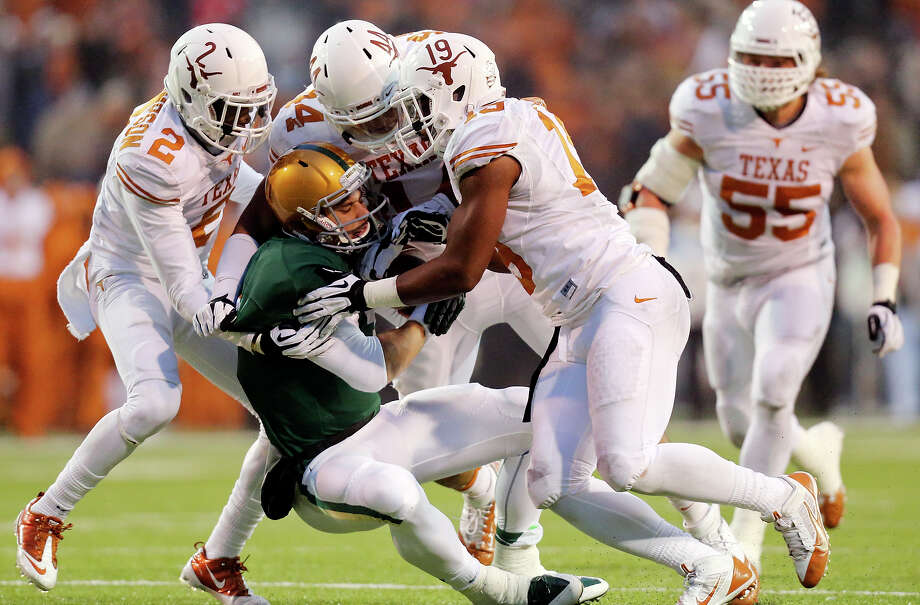 Baylor Bears quarterback Bryce Petty is sacked by Texas Longhorns defensive end Jackson Jeffcoat (center) with help from Texas Longhorns safety Mykkele Thompson (left) and Texas Longhorns linebacker Peter Jinkens during second half action Saturday Dec. 7, 2013 at Floyd Casey Stadium in Waco, Tx. Baylor won 30-10. Photo: Edward A. Ornelas, San Antonio Express-News / © 2013 San Antonio Express-News