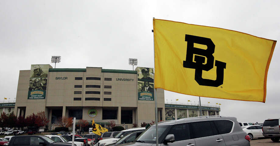 A Baylor flag flies outside Floyd Casey Stadium before the Baylor Bears and Texas Longhorns game Saturday Dec. 7, 2013 at in Waco, Tx. Photo: Edward A. Ornelas, San Antonio Express-News / © 2013 San Antonio Express-News