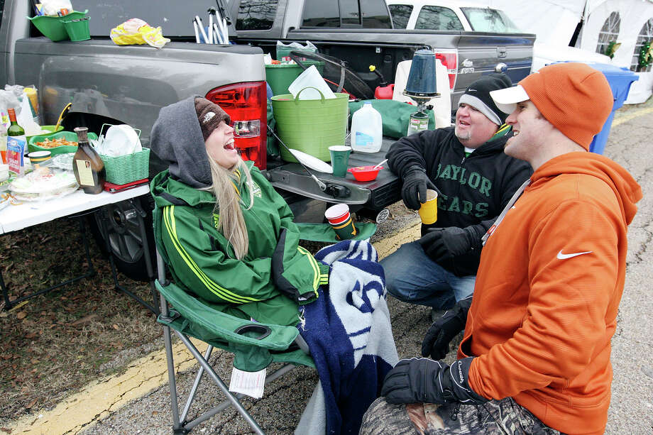 Lacey Ballew (from left), Greg Walker, and Jeremy Ballew joke while tailgating before the Baylor Bears and Texas Longhorns game Saturday Dec. 7, 2013 at Floyd Casey Stadium in Waco, Tx. Photo: Edward A. Ornelas, San Antonio Express-News / © 2013 San Antonio Express-News