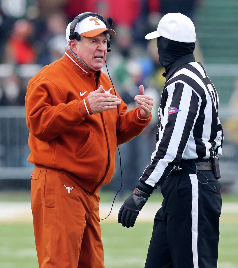 Texas Longhorns head coach Mack Brown (left) talks with a referee during first half action against the Baylor Bears Saturday Dec. 7, 2013 at Floyd Casey Stadium in Waco, Tx. Photo: Edward A. Ornelas, San Antonio Express-News / © 2013 San Antonio Express-News