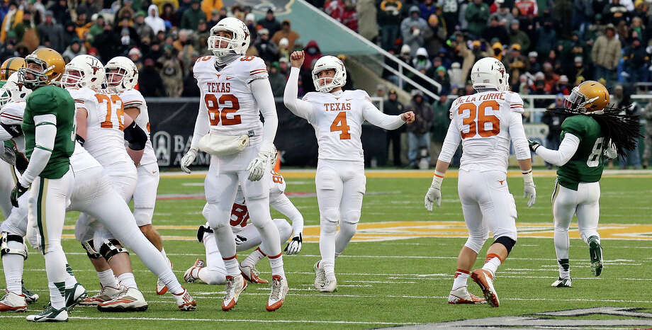 Texas Longhorns kicker Anthony Fera (center) watches his field goal against the Baylor Bears during first half action Saturday Dec. 7, 2013 at Floyd Casey Stadium in Waco, Tx. Photo: Edward A. Ornelas, San Antonio Express-News / © 2013 San Antonio Express-News