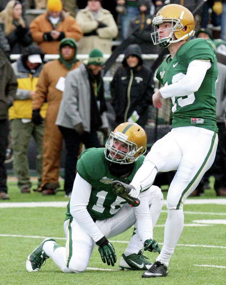 Baylor Bears linebacker Brody Trahan (left) and Baylor Bears kicker Aaron Jones  watch Jones' field goal during first half action against the Texas Longhorns Saturday Dec. 7, 2013 at Floyd Casey Stadium in Waco, Tx. Photo: Edward A. Ornelas, San Antonio Express-News / © 2013 San Antonio Express-News
