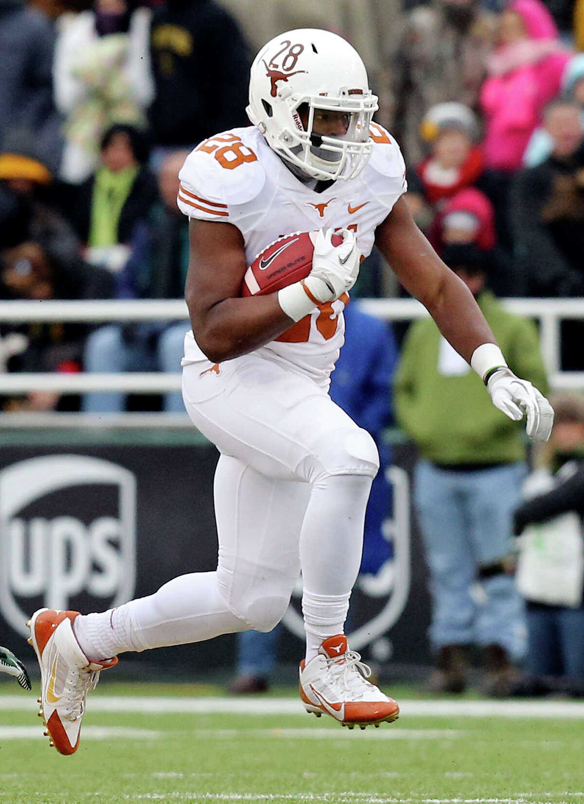 Texas Longhorns running back Malcolm Brown heads up field against the Baylor Bears during first half action Saturday Dec. 7, 2013 at Floyd Casey Stadium in Waco, Tx.
