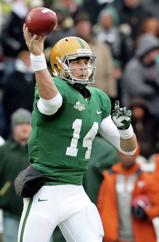 Baylor Bears quarterback Bryce Petty passes against the Texas Longhorns during first half action Saturday Dec. 7, 2013 at Floyd Casey Stadium in Waco, Tx. Photo: Edward A. Ornelas, San Antonio Express-News / © 2013 San Antonio Express-News