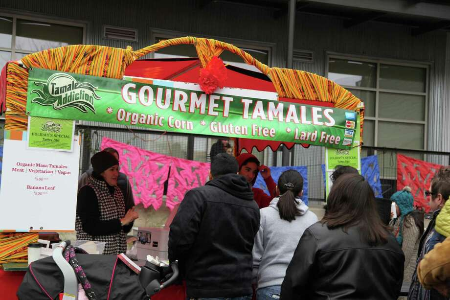 Folks enjoy tamales and entertainment during Tamales at Pearl on Saturday, Dec. 7, 2013. Photo: Xelina Flores-Chasnoff / For MySA.com