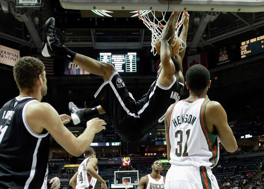 RETRANSMISSION TO CORRECT ID TO ALAN ANDERSON - Brooklyn Nets' Alan Anderson dunks during the first half of an NBA basketball game against the Milwaukee Bucks Saturday, Dec. 7, 2013, in Milwaukee. (AP Photo/Morry Gash)  ORG XMIT: WIMG101 Photo: Morry Gash / AP