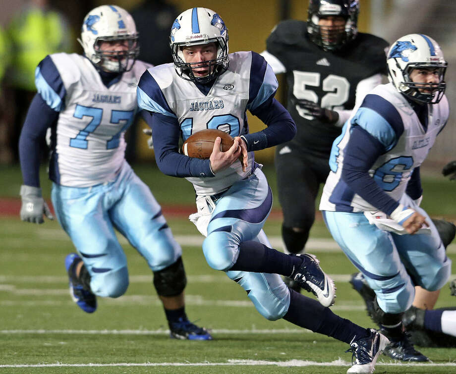 Johnson QB Hunter Rittimann, who rushed for 76 yards and a touchdown and threw five TD passes, breaks into the open field for the Jaguars. Photo: Tom Reel / Express-News