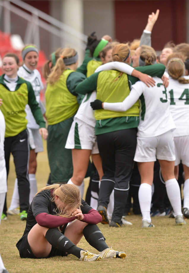 Trinity's Shelby Guenthardt sits dejectedly as William Smith's players celebrate their NCAA D-III title. Photo: Robin Jerstad / For The Express-News