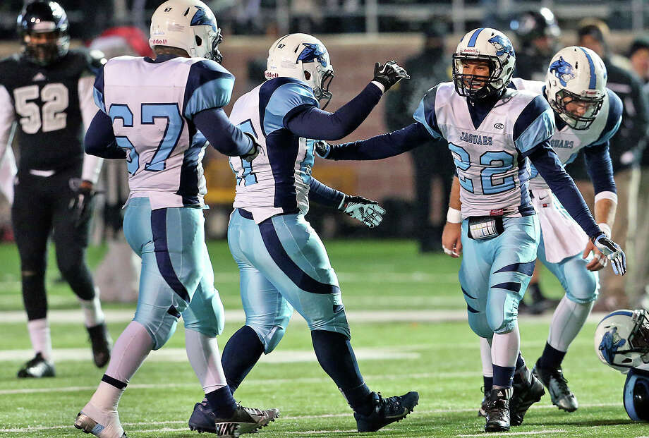 Jaguars begin to celebrate the victory after recovering an onside kick as Johnson beats Steele 42-41 at Bobcat Stadium in the 5A quarterfinals on December 7, 2013. Photo: Tom Reel, San Antonio Express-News