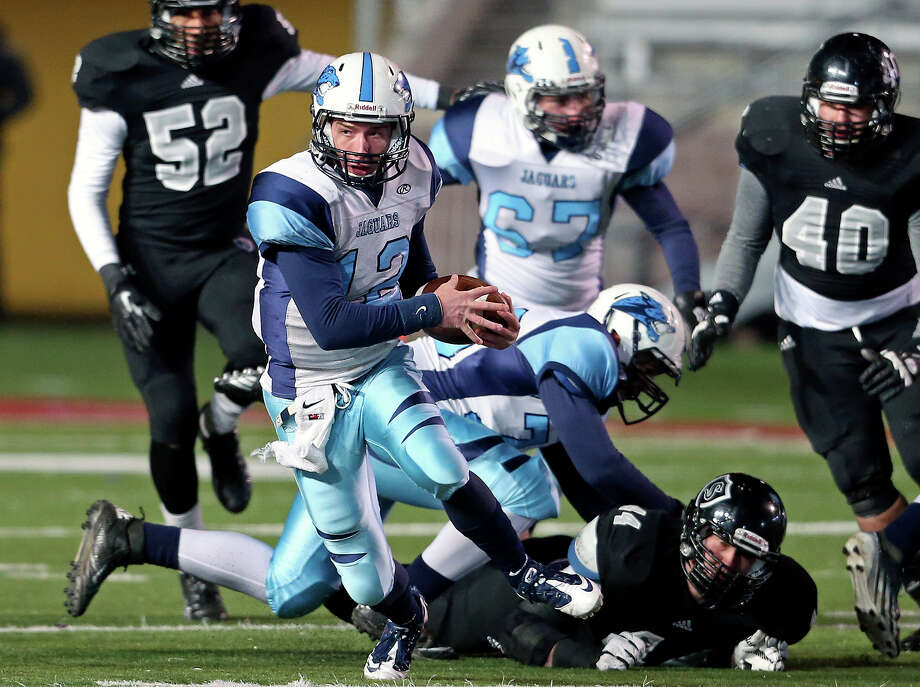 Jaguar quarterback Hunter Rittimann scrambles the field as Johnson beats Steele 42-41 at Bobcat Stadium in the 5A quarterfinals on December 7, 2013. Photo: Tom Reel, San Antonio Express-News