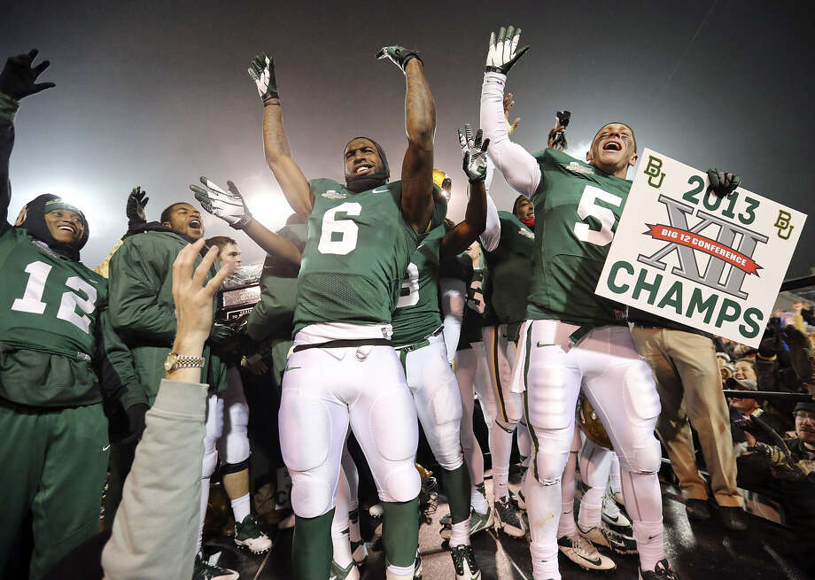 Baylor players celebrate their first Big 12 championship after defeating Texas in the final game at Floyd Casey Stadium in Waco. Photo: Edward A. Ornelas / San Antonio Express-News