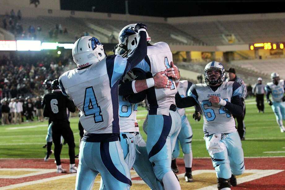 Josh Theissen (1) is congratulated after catching a pass for the last Johnson TD in a 42-41 Region IV playoff win over Steele in San Marcos on Dec. 7. Photo: TOM REEL, San Antonio Express-News / San Antonio Express-News