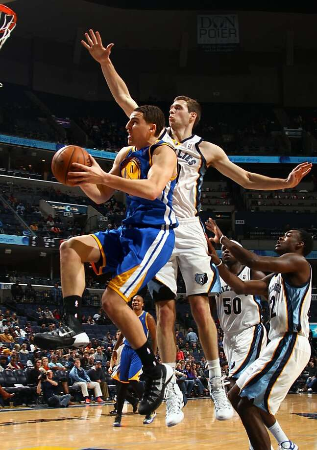 The Golden State Warriors' Klay Thompson (11) shoots while defended by the Memphis Grizzlies' Jon Leuer at the FedExForum in Memphis, Tenn., on Saturday, Dec. 7, 2013. Golden State won, 108-82. (Nikki Boertman/The Commercial Appeal/MCT) Photo: Nikki Boertman, McClatchy-Tribune News Service