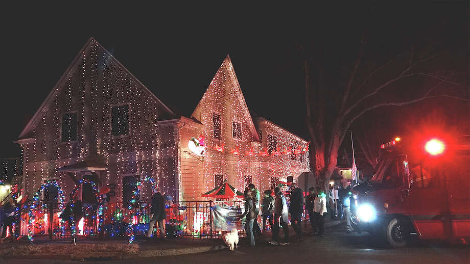 Thousands of lights and other decorations festoon the Papageorge house on Kings Highway East. Photo: Mike Lauterborn / Fairfield Citizen contributed