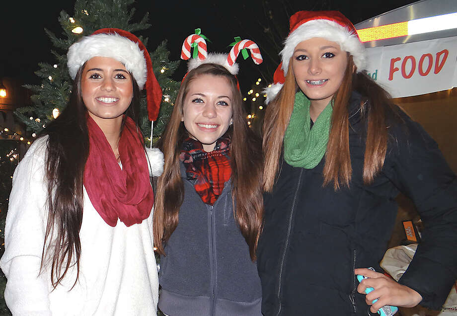 Sixteen-year-old Norwalk residents Megan Giglio, Margaret Deering and Susie McCarthy at the Papageorge family's house lighting Saturday at 2011 Kings Highway East. Photo: Mike Lauterborn / Fairfield Citizen contributed